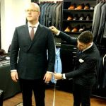 Man-getting-fitted-in-suit-by-tailor